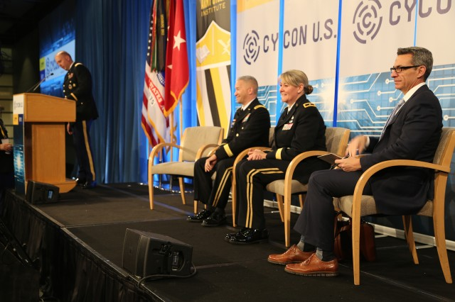Brig. Gen. Jennifer Buckner, second from right, director of cyber within the Army's G3/5/7 office, participates in a panel discussion at the International Conference on Cyber Conflict U.S. in Washington, D.C., Nov. 15, 2018. CyCon U.S. ensures outreach to bridge gaps and to promote information exchange across Army, military, and academic, industry, and government cyber communities.