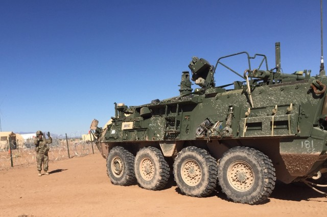 Sgt. 1st Class Chasity Welch, a native of Cincinnati, Ohio, assigned to Headquarters Company, 40th Brigade Engineer Battalion, ground guides a Nuclear/Biological/Chemical Reconnaissance Vehicle (NBC-RV) into position Nov. 13 at a training site on Fort Bliss, Texas. Welch and her Soldiers were in support of the Warfighter 19-2 exercise from November 4-15. The purpose of the exercise was to train the 1st Armored Division in a demanding exercise testing America's Tank Division and its Soldiers on all warfighting functions while simultaneously conducting operations in a simulated, complex combat environment.