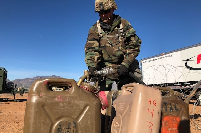Sgt. 1st Class Derick Pentz from Bradenton, Fla., fills up several fuel containers in preparation to refuel generators at the division's main command post Nov. 14 during the Warfighter 19-2 exercise at Fort Bliss, Texas. Pentz is a master gunner assigned to the Headquarters Company, 1st Armored Division.