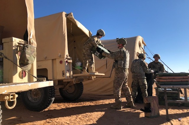 Soldiers assigned to the 153rd Field Feeding Company work together to unload and prepare for the morning meal Nov. 14 outside of the main command post at Fort Bliss, Texas. These Soldiers were a vital part of the exercise of this magnitude to ensure Soldiers are getting the proper nutrition in a demanding training environment. Warfighter 19-2 was conducted among multiple division and brigade elements from November 4-15.
