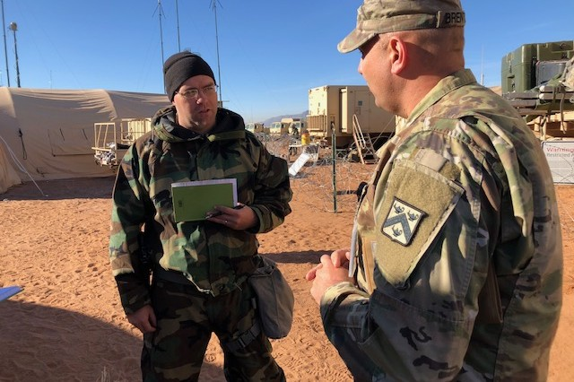 Lt. Col. Joe Hammond, chief of Information Operations for the 1st Armored Division, receives feedback from Lt. Col. Thomas Brenton, Observer-Coach/Trainer, Information Operations, assigned to the Mission Command Training Program during his evaluation session as part of Warfighter 19-2 Nov. 14 at Fort Bliss, Texas. OC/Ts shared their expertise with participants with the intent to strengthen each unit's warfighting capabilities and staff processes.