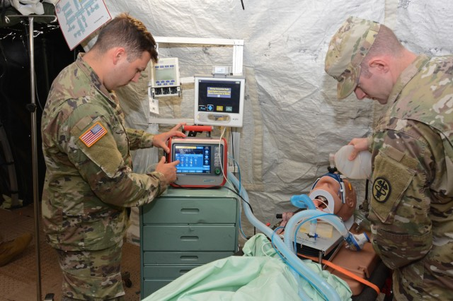 Medical Soldiers testing the intrathoracic pressure regulation therapy device.