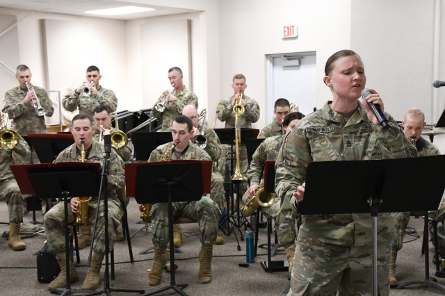Sgt. 1st Class Christine Permenter, 10th Mountain Division Band vocalist, practices a song during the rehearsal Nov. 15 in preparation for the holiday concert series in December. (Photo by Mike Strasser, Fort Drum Garrison Public Affairs)