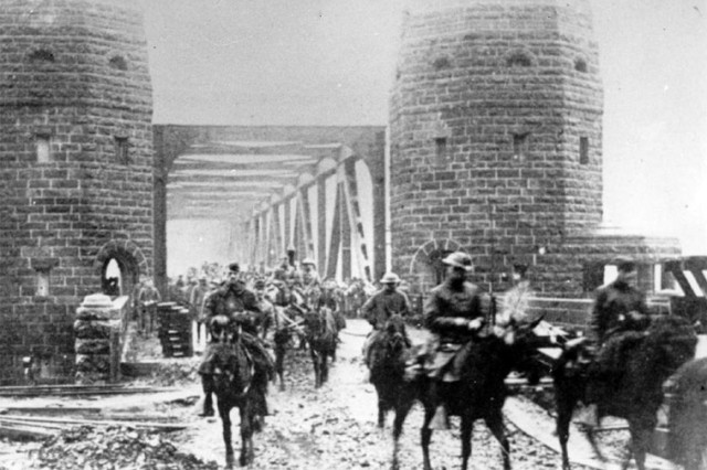 U.S. Army National Guard Soldiers assigned to the 165th Infantry Regiment, 42nd Division, the former 69th New York, pass through the Ludendorff Bridge at Remagen, Germany as they assume occupation duties December 13, 1918. The 165th Infantry was renamed from the New York National Guard 69th Infantry Regiment, based in New York City and comprised mainly of Soldiers from Irish lineage. The 42nd Division, known as the Rainbow Division for its inclusion of various National Guard units from across the United States, served as an occupation force in the Rhineland following the armistice that ended World War I. The division served in Germany until April 1, 1919 when it embarked for its journey home.