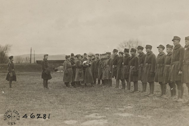 With Army Maj. Gen. Clement Alexander Finley Flagler, commander of the 42nd Division and his staff looking on, Lt. C.L. Michaels reads the order directing the 117th Trench Mortar Battery, 42nd Division, to prepare for redeployment home from Kreuzberg, Germany following the end of occupation duties January 3, 1919, following World War I. The Soldiers originally served in the 3rd and 4th Companies Maryland National Guard's Coastal Artillery before mobilization. The 42nd Division, known as the Rainbow Division for its inclusion of various National Guard units from across the United States, served as an occupation force following the armistice that ended World War I. The division served in Germany until April 1, 1919 when it embarked for its journey home.