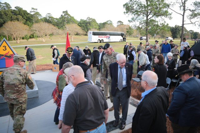 FORT BENNING, Ga. (Nov. 19, 2018) -- Members of the Association of the 3rd Armored Division Veterans, arriving by the busload, attended the 3rd Armored Division Monument dedication ceremony at Patton's Park outside of the Benning Road Gate Nov. 17. (U.S. Army photo by Markeith Horace, Maneuver Center of Excellence, Fort Benning Public Affairs)