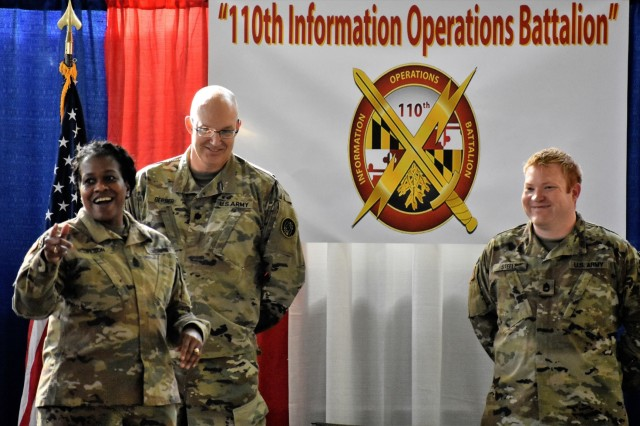 U.S. Army Sgt. 1st Class Quintin C. Steele, intelligence specialist, stands with Sgt. Maj. Perlisa D. Wilson, senior enlisted leader, and Lt. Col. Stephen P. Gerber, a senior intelligence officer, during a promotion ceremony at the 110th Information Operations Battalion Nov 18 in Annapolis, Md. Steele's promotion speech sparked an emotional expression of gratitude to his unit for the support he received as his family lived through the devastation of Hurricane Michael in Panama City, Fla.