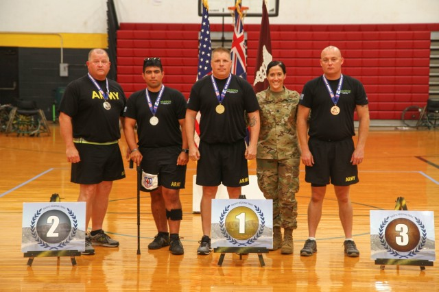 U.S. Army Staff Sgt. Jeffery Keith(right), a Kansas native assigned to the Warrior Transition Battalion (WTB) from Fort Riley, was awarded the bronze medal in air pistol during the 2018 Pacific Regional Trails shooting event hosted by the Tripler Army Medical Center's WTB, Nov. 14, Schofield Barracks, Hawaii.