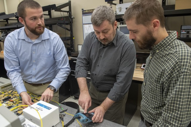 The lab's research team sets up an experiment on the Quantum Networking Testbed as part of their work to provide more secure and reliable communication for warfighters on the battlefield.