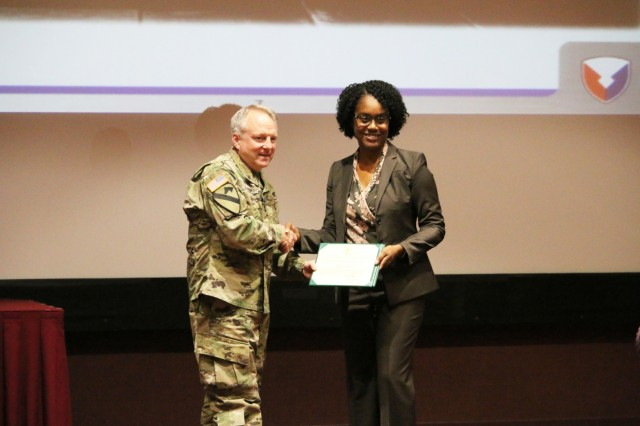 Alysia Greer, a G-1 Human Resource specialist assigned to the U.S. Army Aviation and Missile Command, receives the AMCOM MVP award during the Aug. 22 AMCOM Town Hall.