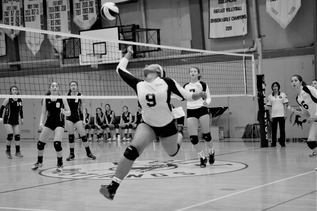 Zama's Grace Bryant, No. 9, stretches to make a spectacular save during a volleyball match Oct 13, 2018. Zama's squad earned a 2nd place finish in the Far East Division II Volleyball Championship on Nov. 10, 2018, at Camp Humphreys, South Korea. Bryant was named the tournament's Most Valuable Player.