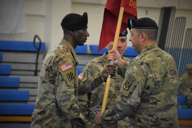 Lt. Col. John D. Wilson passes the guidon to Sgt. Maj. Ramirez and assumes command as the first National Guard Officer of an active duty Air Defense Combined Task Force.