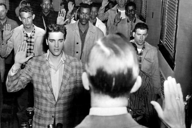 A drafted Elvis is sworn into the Army.