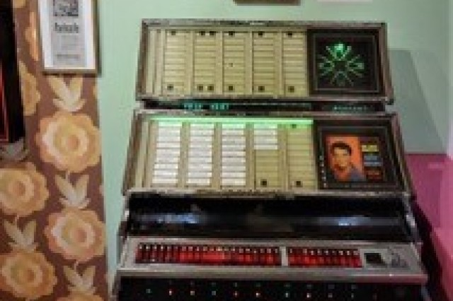 A vintage jukebox loaded with the songs of Elvis is part of the museum exhibit.