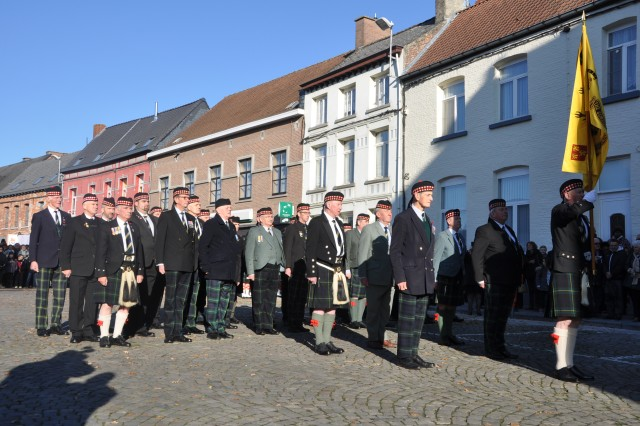 The members of the Gordon Highlanders Regimental Association stand in front of the town hall of Chièvres, Belgium, in a ceremony during which they offered their Regiment flag to the city during the centennial weekend, Nov. 18, 2018.