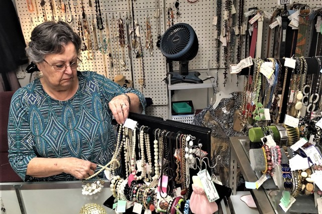Fort Myer Thrift Shop volunteer Maria Randolph works the jewelry counter in the boutique section of the shop earlier this month. Maria, a 50-year volunteer at the thrift shop, will work her final shift Tuesday.