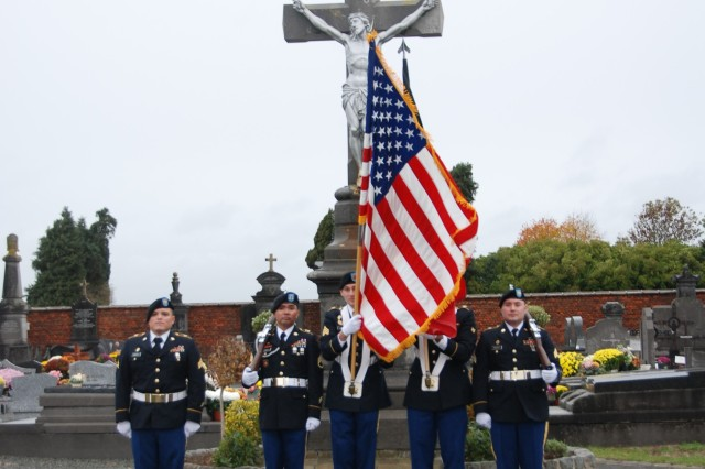 The USAG Benelux Color Guard presents the colors during a ceremony held at the Chièvres cemetery Nov. 11, 2018. From left to right: Sgt. Erik Ramirez (NCOIC), Sgt. Villamor Madrigal, Sgt. Douglas Lanning, Spc. J'Marcus Carson, and Sgt. Jacob Doughty.