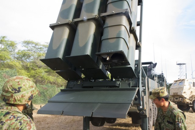 180712-A-FJ530-1084 PACIFIC MISSILE RANGE BARKING SANDS, Hawaii (July 12, 2018) Members of the Western Artillery Japan Ground Self-Defense Force (JGSDF) examine their equipment after the launch of a surface-to-ship missile at Pacific Missile Range Facility Barking Sands, July 12. The JGSDF alongside the 17th Field Artillery Brigade, headquarters of the U.S. Army's Multi Domain Task Force Pilot Program, conducted a joint live-fire exercise in support of the Rim of the Pacific (RIMPAC) exercise. Twenty-five nations, 46 ships, and five submarines, and about 200 aircraft and 25,000 personnel are participating in RIMPAC from June 27 to Aug. 2 in and around the Hawaiian Island and Southern California.  The world's largest international maritime exercise, RIMPAC provides a unique training opportunity while fostering and sustaining cooperative relationships among the participants critical to ensuring the safety of sea lanes and security on the world's oceans. RIMPAC 2018 is the 26th exercise in the series that began in 1971. (U.S. Army photo by Capt. Rachael Jeffcoat/Released)