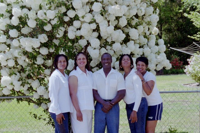 Retired Sgt. Maj. James Miller poses with his four daughters, all of whom have served in the Army. From left, Dianna Adams, Theresa Miller, James Miller, Amaryillis Miller and Faith LaJoy Newman.