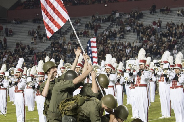 An homage to the famous photograph 'Raising of the Flag at Iwo Jima' takes place Nov. 17 midfield at William-Brice Stadium during the University of South Carolina's annual Salute to Service.