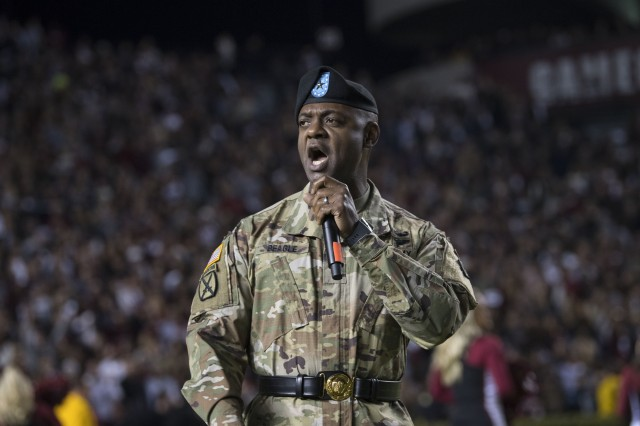 Brig. Gen. Milford 'Beags' Beagle, Jr., Fort Jackson commanding general, gets the crowd fired up at the start of the game.