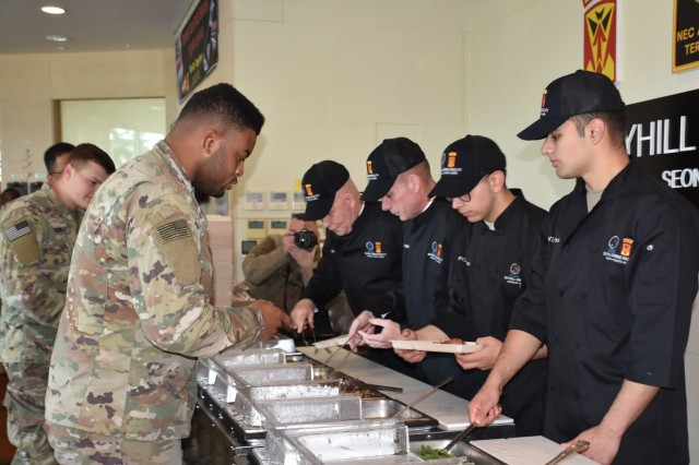 Lt. Gen. Michael A. Bills, Eighth Army commanding general; and Command Sgt. Maj. Jason Schmidt, serve up the Thanksgiving meal to U.S. and ROK soldiers at CTF Defender.