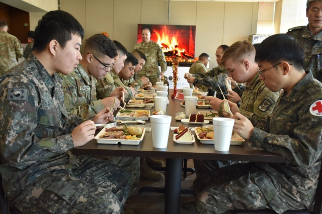 The grand opening of the new Skyhill Dining Facility at CTF Defender brought both U.S. and ROK soldiers together to share a Thanksgiving meal.