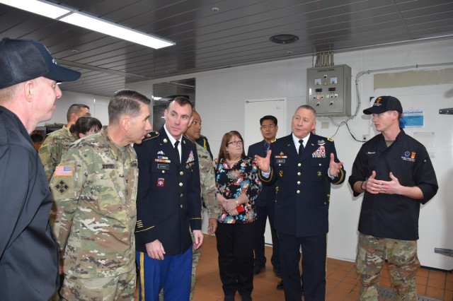 35th ADA Brigade food service officer Chief Warrant Officer 2 River Mitchell gives the 8A and 35th ADA command teams a tour of the new Skyhill Dining Facility Kitchen where soldiers prepared the Thanksgiving dinner.