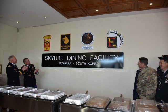 Lt. Gen. Michael A. Bills, Eighth Army commanding general; Brigadier Gen. Kim Tae Up, Eighth Army deputy commanding general; and Command Sgt. Maj. Jason Schmidt, Eighth Army command sergeant major; and Col. Richard Wright, 35th Air Defense Artillery Brigade commander unveiled the new Skyhill Dining Facility Sign.