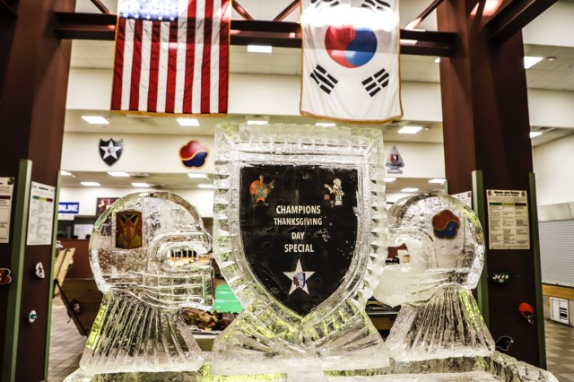 CAMP CARROLL, Republic of Korea - The Champion Cafe displays a unique, football-themed ice sculpture for their Thanksgiving meal to give Soldiers a taste of home, build morale and esprit de corps Nov. 22. Each dining facility created a unique display to create a welcoming, festive environment.
