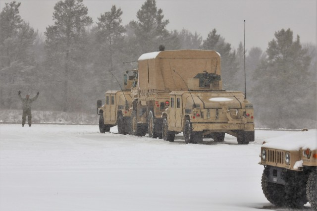 Soldiers at Fort McCoy, Wis., training at Operation Cold Steel II exercise prepare for a training scenario on a snowy day, April 3, 2018, at Fort McCoy, Wis. Operation Cold Steel II is a validation exercise to ensure Army Reserve units and Soldiers are trained and ready to deploy on short notice as part of Ready Force X, according to the Army Reserve.