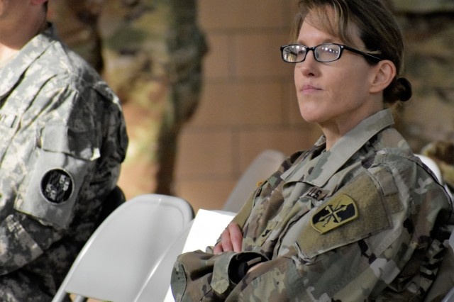 U.S. Army Col. Julie M. Minde, 58th Expeditionary Military Intelligence Brigade commander, listens to various speakers during the Maryland Army National Guard's Information and Cyber Operations Symposium hosted by the 110th Information Operations Battalion Nov 18 at the Annapolis Readiness Center.