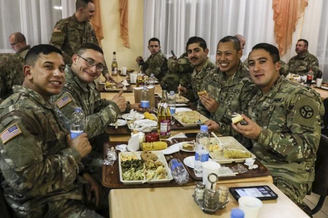 278th Armored Cavalry Regiment Soldiers enjoy Thanksgiving dinner at Yavoriv, Ukraine, Nov. 22.