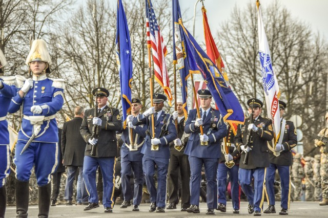 Army and Air Michigan National Guard members, along with other services, represent the United States of America at the Latvian Centennial Parade in Riga, Latvia, Nov. 18, 2018. Michigan was invited to carry the American colors because of the unique relationship between the armed forces of Latvia and the Michigan National Guard resulting from their 25-year State Partnership.