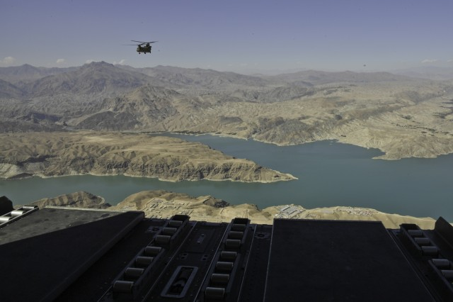 A CH-47 helicopter flies over the terrain and air space of Afghanistan during a flight operation Oct 14 2018.