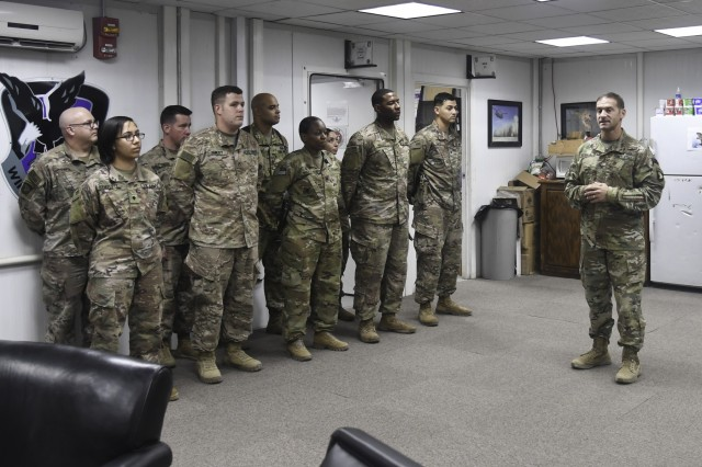 U.S. Army Soldiers assigned to Task Force Destiny receive the 101st airborne Division air assault combat patch at Bagram Airfield, Afghanistan Nov. 1, 2018.