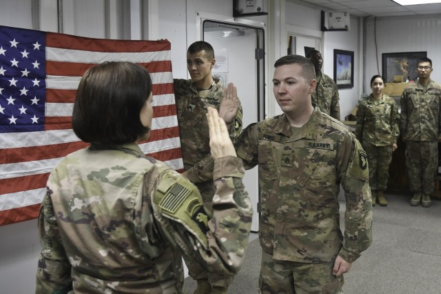 U.S. Army Staff Sgt. Zachary Powell, a 25L cable systems installer-maintainer from Atlanta, Indiana, Task Force Destiny's command group non-commissioned officer in charge, takes the oath of enlistment at Bagram Airfield, Afghanistan Nov. 1, 2018. Powell has served in the military for seven years. Join us in congratulating Staff Sgt. Powell for choosing to serve five more years!