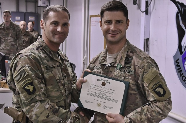 Cpt. David Taylor, Task Force Destiny Brigade Surgeon, receives the Army Commendation Medal at Bagram Airfield, Afghanistan Oct. 15, 2018.  Taylor will continue to support operations from home station.