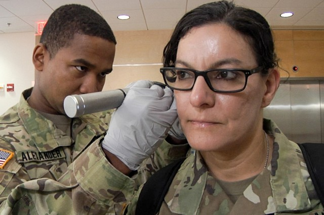 Army Reserve Medical Command Soldiers with the 7250th Medical Support Unit, from Alexandria, Virginia, provide medical care for Sgt. Maj. Susan Rivera and her fellow Soldiers as part of Operation Capital Medic. Operation Capital Medic, an initiative to maintain Soldier's individual medical readiness, is hosted in partnership between Army Reserve Medical Command personnel and the Fort Belvoir Community Hospital.   The initiative has assisted more than 1500 Soldiers to become medically deployable since August of 2017.