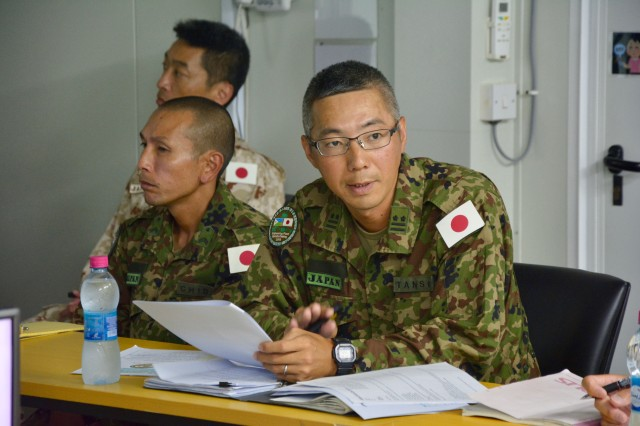 Japan Ground Self-Defense Force Col. Masatoshi Tanso briefs U.S. Army Lt. Col. Kenneth Kim, commander of the 403rd Civil Affairs Battalion, Mattydale, New York, during a key leadership engagement at Japan Self-Defense Force Base, Djibouti, Nov. 21, 2018. Japanese and U.S. leadership met to discuss ways to build relationships across the Combined Joint Operations Area.