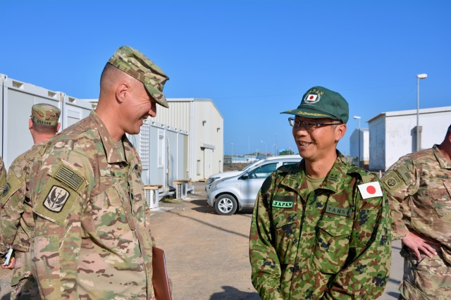 U.S. Army Lt. Col. Kenneth Kim, commander of the 403rd Civil Affairs Battalion, Mattydale, New York, greets Japan Ground Self-Defense Force Col. Masatoshi Tanso during a key leadership engagement at Japan Self-Defense Force Base, Djibouti, Nov. 21, 2018. Japanese and U.S. leadership met to discuss ways to build relationships across the Combined Joint Operations Area.