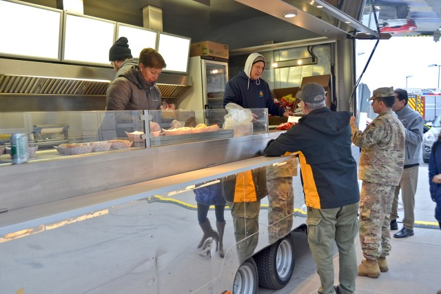 Members of the Wiesbaden MWR staff serve free food during the Automotive Skills Center's Customer Appreciation event Nov. 20, 2018.
