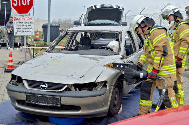 Members of the Wiesbaden military community Fire Department demonstrate the jaws of life during the Automotive Skills Center's Customer Appreciation event on Nov. 20, 2018.