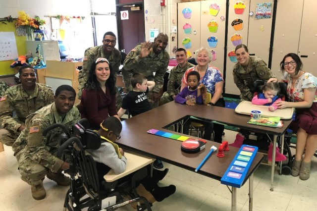 The 20th Chemical, Biological, Radiological, Nuclear, Explosives Command color guard visited the children in their classroom after the assembly. From the left: Spc. Tedrick Jackson, Sgt. William Pridgen, Spc. Jason Rubio, Sgt 1st Class John Binot, Spc. Corey McClendon, and Spc. Kayla Riehl. The audience included teachers, staff, family members and local veterans.
