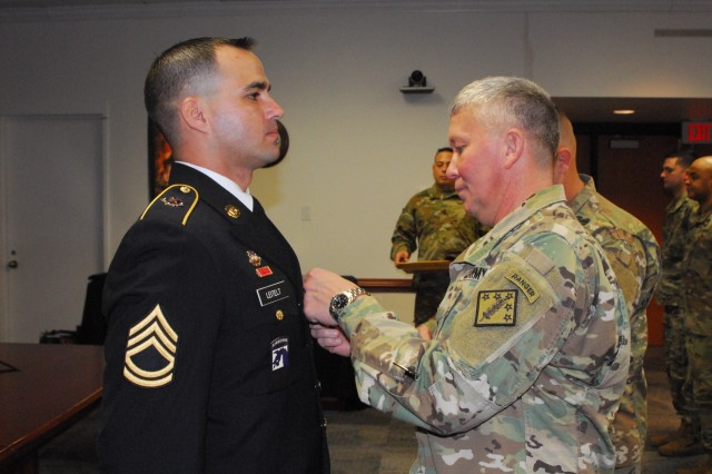 Brig. Gen. James Bonner, commander of the 20th Chemical, Biological, Radiological, Nuclear, Explosives (CBRNE) Command, pins the Army Achievement Medal on Sgt. 1st Class Robert Leitelt for his selection as the 2019 20th CBRNE Command Career Counselor of the Year during the Nov. 16 ceremony at Aberdeen Proving Ground. Leitelt, a Chicago native who serves with the 83rd CBRN Battalion at Fort Stewart, Georgia, won the competition for the second year in a row.