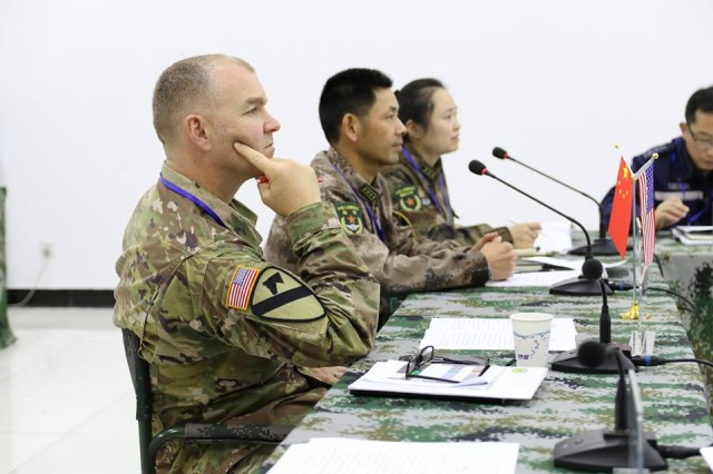 Col. Geoffrey Van Epps, 130th Engineer Brigade Commander participates in the table top exchange portion of the Disaster Management Exchange, Nov. 13 in Nanjing China. The TTE discusses disaster planning and coordination. The DME is an annual USARPAC and PLA disaster risk reduction event, which underscores the commitment of both U.S. and the PRC to address Humanitarian Assistance and Disaster Relief challenges across the region. The 2018 DME focused on an international disaster relief scenario following a hypothetical devastating earthquake in a third country.