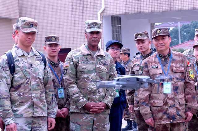 Maj. Gen. Charles R. Hamilton, commanding general for the 8th Theater Sustainment Command and Maj. Gen. Yu Qifeng, chief of staff for the PLA, 72nd Group Army observe demonstrations on PLA drone capabilities during the static display of the opening ceremony of the 2018 Disaster Management Exchange held in Nanjing, China, Nov. 13-18. The DME is an annual USARPAC and PLA disaster risk reduction event, which underscores the commitment of both U.S. and the PRC to address Humanitarian Assistance and Disaster Relief challenges across the region. The 2018 DME focused on an international disaster relief scenario following a hypothetical devastating earthquake in a third country.