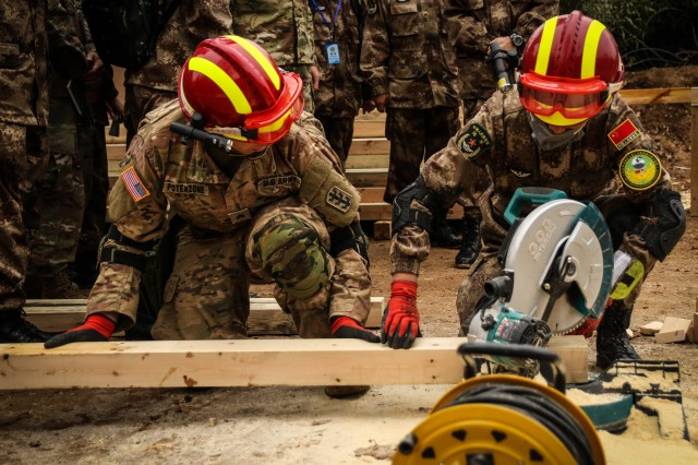 U.S. Army and PRC PLA Soldiers conduct basic construction tasks during the practical field exchange portion of the 2018 Disaster Management Exchange, 13-18 Nov. in Nanjing, China. The DME is an annual USARPAC and PLA disaster risk reduction event, which underscores the commitment of both U.S. and the PRC to address Humanitarian Assistance and Disaster Relief challenges across the region. The 2018 DME focused on an international disaster relief scenario following a hypothetical devastating earthquake in a third country.