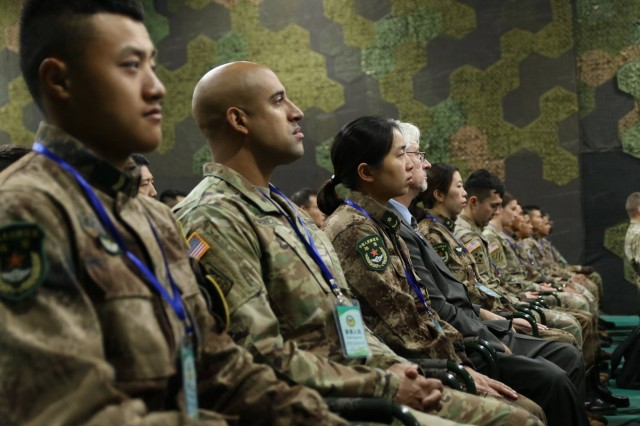 U.S. Army and PRC PLA Soldiers sit side-by-side during the 2018 Disaster Management Exchange opening ceremony, 14 Nov., in Nanjing, China. The DME is an annual USARPAC and PLA disaster risk reduction event, which underscores the commitment of both U.S. and the PRC to address Humanitarian Assistance and Disaster Relief challenges across the region. The 2018 DME focused on an international disaster relief scenario following a hypothetical devastating earthquake in a third country.