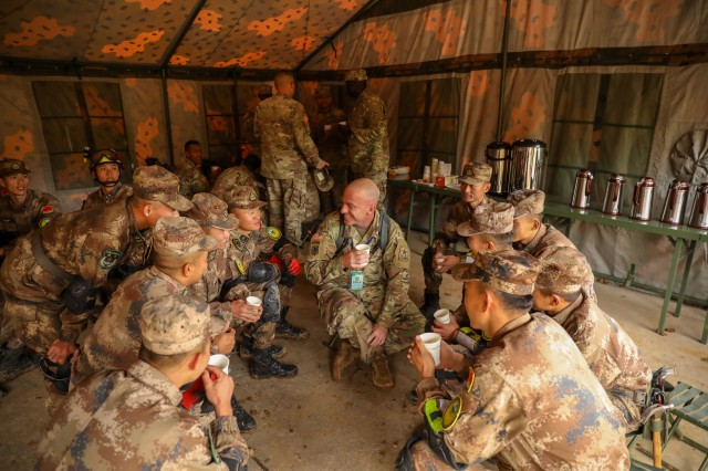 A U.S. Army Soldier enjoys a tea break with PRC PLA Soldiers during the practical field exchange of the 2018 Disaster Management Exchange, 13-18 Nov. in Nanjing, China. The DME is an annual USARPAC and PLA disaster risk reduction event, which underscores the commitment of both U.S. and the PRC to address Humanitarian Assistance and Disaster Relief challenges across the region. The 2018 DME focused on an international disaster relief scenario following a devasting earthquake in a third country.